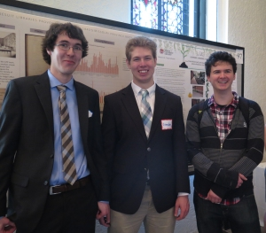 Dan Snow and Brendan Courtois (and fellow Ramonat Scholar Andrew Kelly) in front of the poster on their work analyzing the book trade ledger.